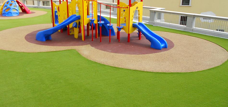 erba sintetica per aree gioco